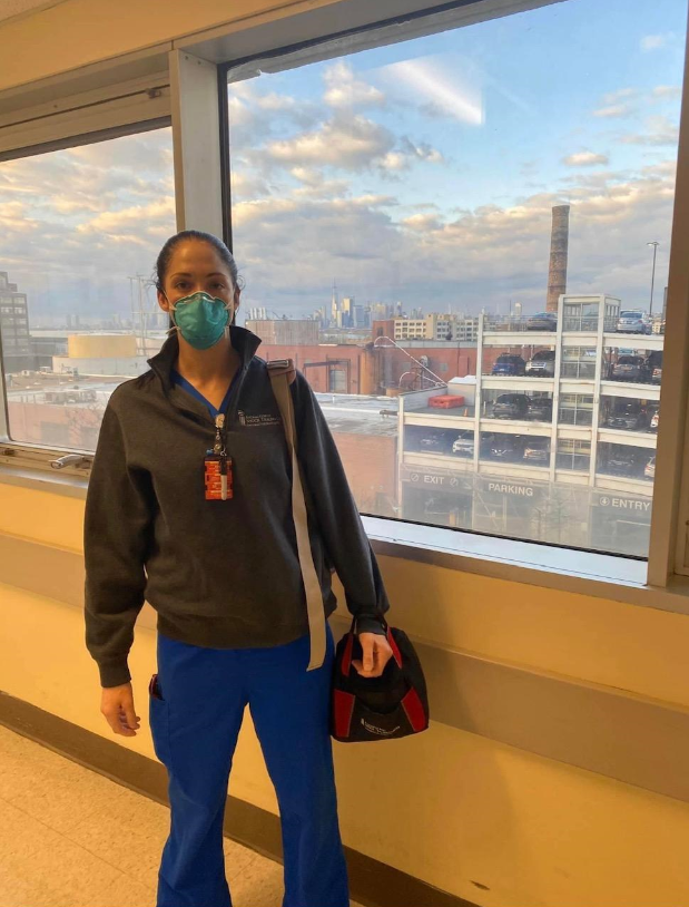 travel nurse poses in front of new york city skyline