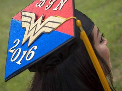Chamberlain alumni, Rocio Sanchez wearing graduation cap