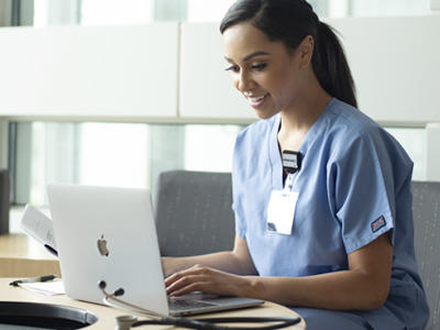 Nurse working on a laptop